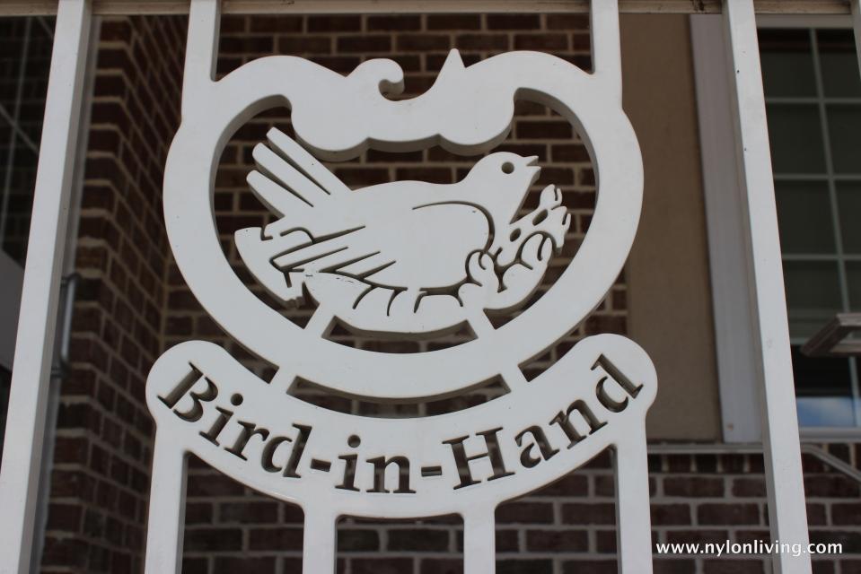 bird in hand symbol