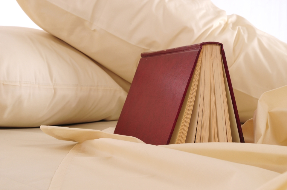 a book on a bed