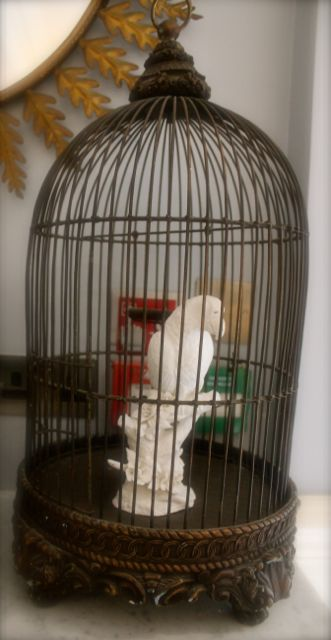bird statue in a birdcage