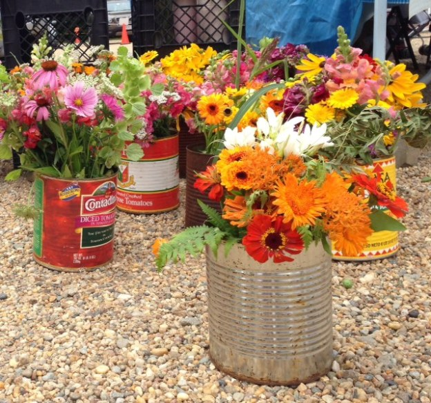 fresh flowers in tin cans
