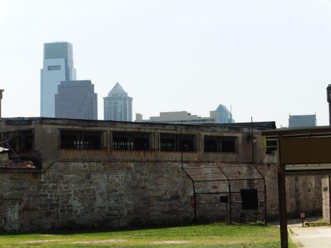 philadelphia skyline rises over eastern penitentiary