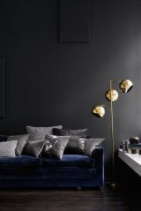 brass lamps with grey walls